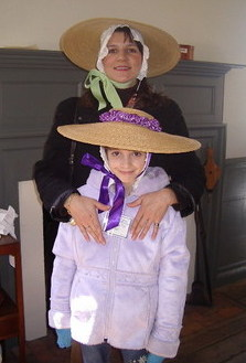 Dressing up in colonial dress at the Benjamin Powell House at Colonial Williamsburg Virginia.