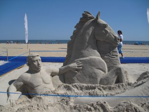 Poseidon emerges fro the sand at The Virginia Beach Neptune Festival.